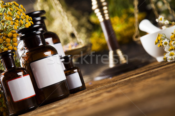 Medicine bottles and herbs background Stock photo © JanPietruszka