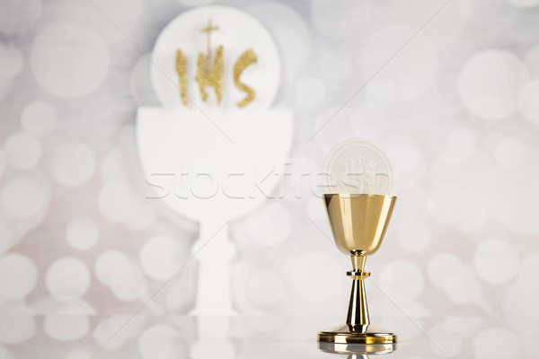 Holy communion a golden chalice, composition isolated on white Stock photo © JanPietruszka