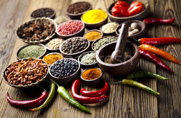 Spices on a wooden table, orintal cuisine vivid theme Stock photo © JanPietruszka