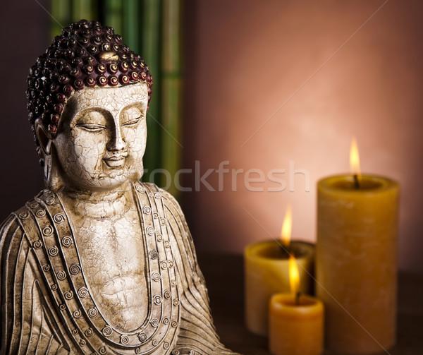 Buddha candela sole fumo relax culto Foto d'archivio © JanPietruszka