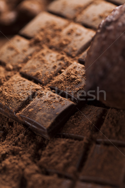 Dark and milk chocolate bar on a wooden table  Stock photo © JanPietruszka