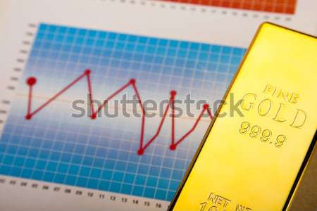 Coins and gold bars, ambient financial concept Stock photo © JanPietruszka
