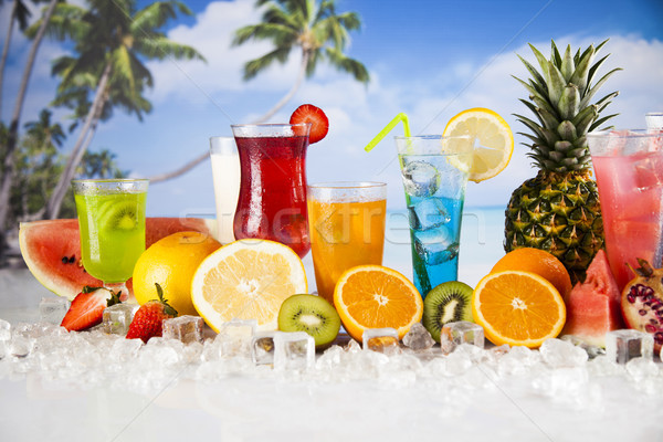 Fresh tropical fruits, Summer drink and palm branch Stock photo © JanPietruszka