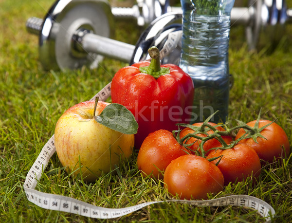 Vitamin and Fitness diet, dumbell in green grass  Stock photo © JanPietruszka