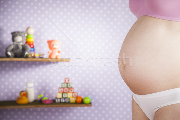 Young pregnant lady touching her belly, Pregnancy concept Stock photo © JanPietruszka