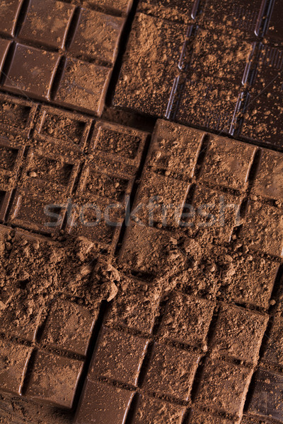 Stock photo: Dark and milk chocolate bar on a wooden table