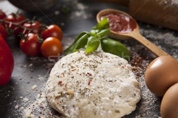 Homemade italian pizza preparation Stock photo © JanPietruszka