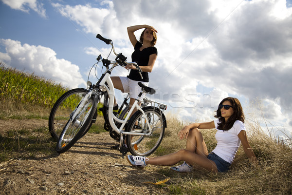 Stock photo: Woman riding bicycle, summer free time spending