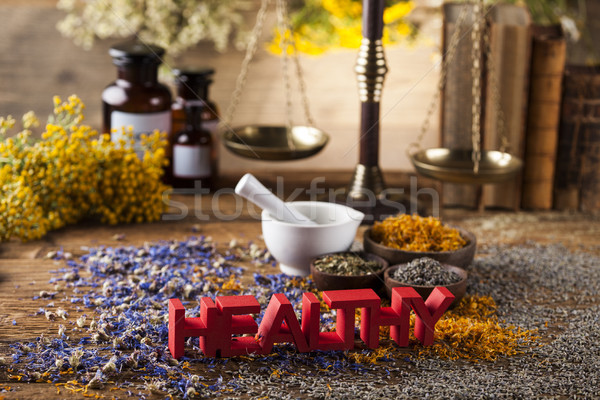 Healthy herbs on wooden table, mortar and herbal medicine  Stock photo © JanPietruszka