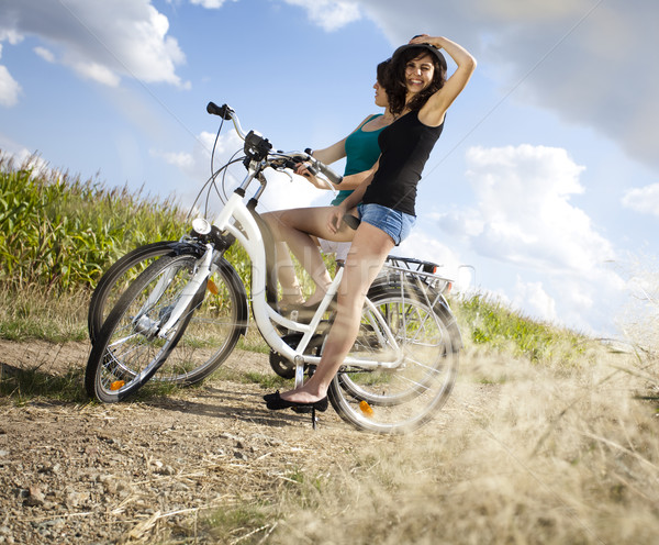 Stock photo: Young woman riding bike, summer free time spending