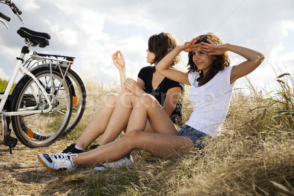 Girl riding her bike, summer free time spending Stock photo © JanPietruszka
