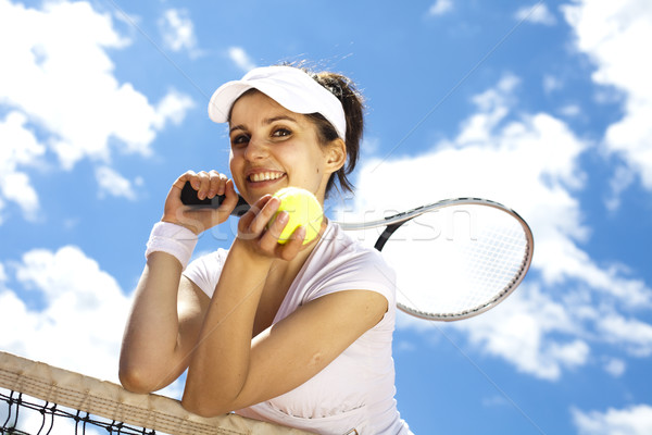 Stock photo: Woman playing tennis in summer