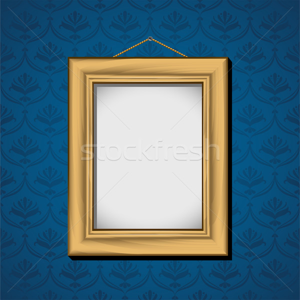 Photoframe hanging on the wall with blue wallpaper Stock photo © jara3000