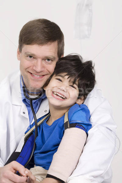 Male doctor holding disabled  toddler patient on lap Stock photo © jarenwicklund