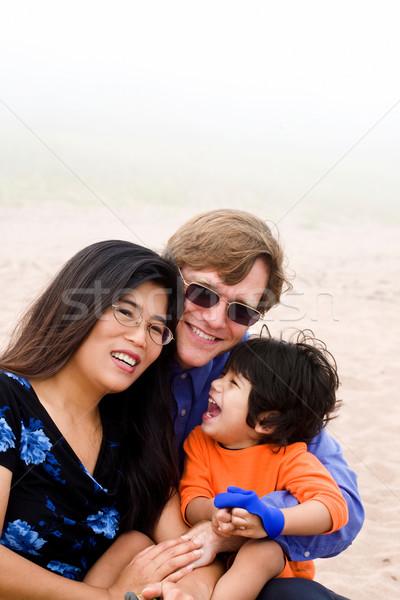Famiglia disabili figlio seduta spiaggia misty Foto d'archivio © jarenwicklund
