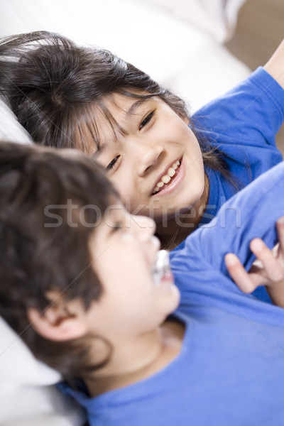 Stock photo: Big sister taking care of her disabled little brother
