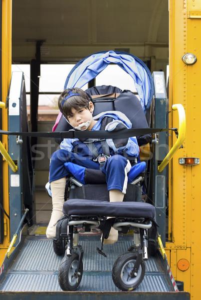 Disabled little boy on school bus wheelchair lift Stock photo © jarenwicklund