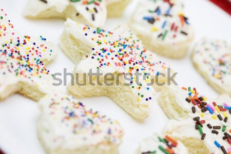 Stock photo: Frosted cake pieces with sprinkles