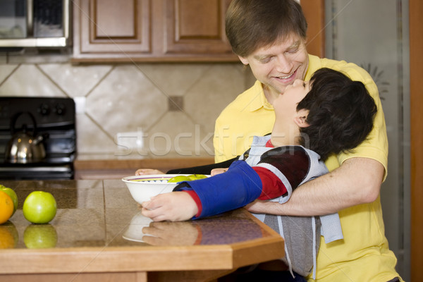 Father helping disabled son with work in the kitchen Stock photo © jarenwicklund