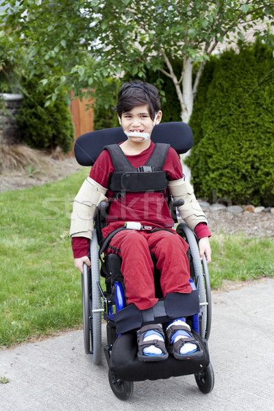 Disabled little boy in wheelchair outdoors  Stock photo © jarenwicklund