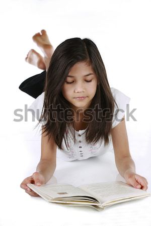Child studying or writing while lying on floor Stock photo © jarenwicklund