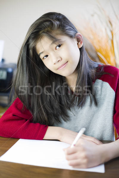 Ten year old girl writing or drawing on paper Stock photo © jarenwicklund