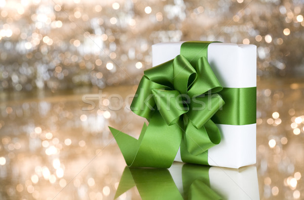 Present with green ribbon on shimmering background Stock photo © jarenwicklund