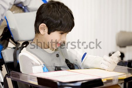Disabled four year old boy studying or reading in wheelchair Stock photo © jarenwicklund