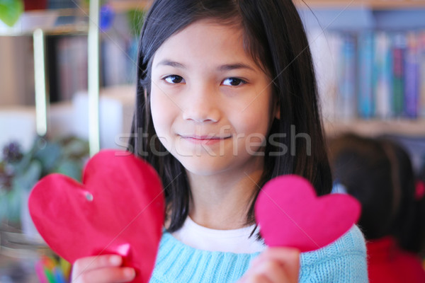 Valentin nap kilenc éves lány magasra tart kettő piros Stock fotó © jarenwicklund
