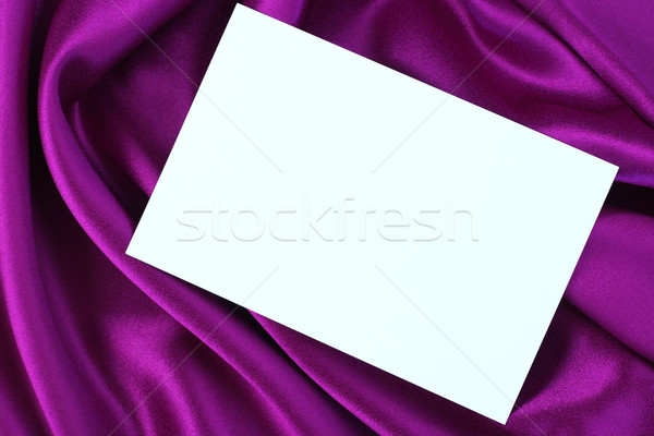 Blank white card on purple satin Stock photo © jarenwicklund