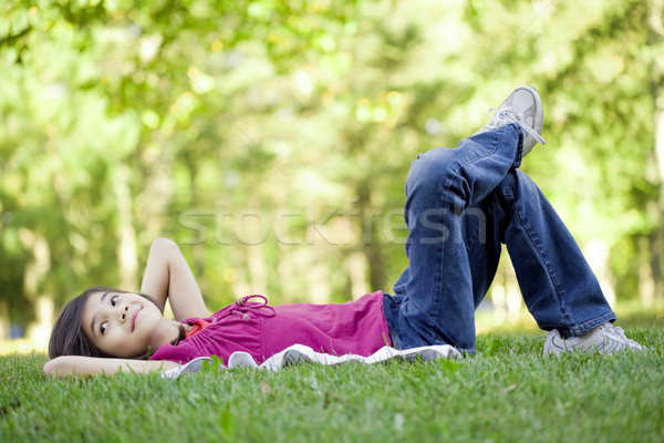 Little girl lying on grass Stock photo © jarenwicklund