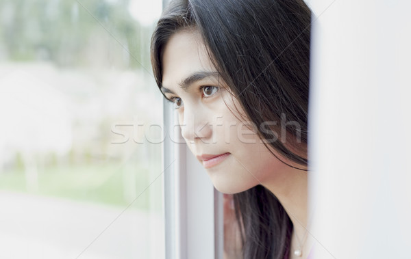 Side profile of teen girl or young woman looking out window Stock photo © jarenwicklund