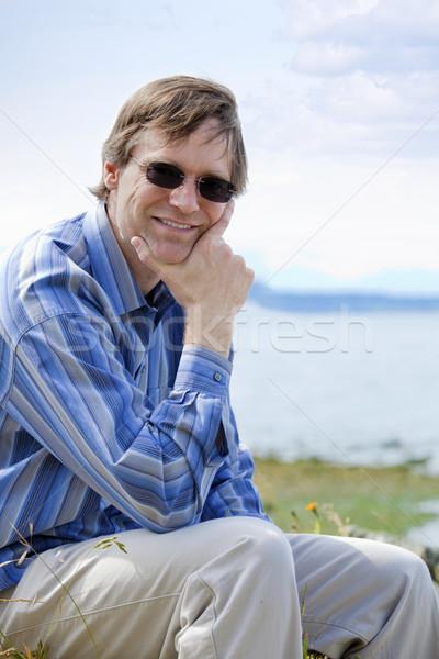 Przystojny człowiek czterdziestki relaks jezioro strona Zdjęcia stock © jarenwicklund