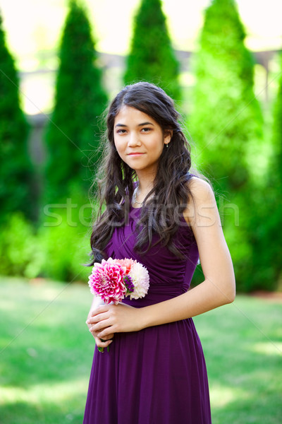 Beautiful biracial bridesmaid in purple dress, smiling Stock photo © jarenwicklund