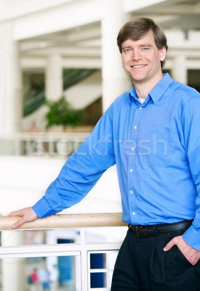 Handsome businessman leaning on railing Stock photo © jarenwicklund