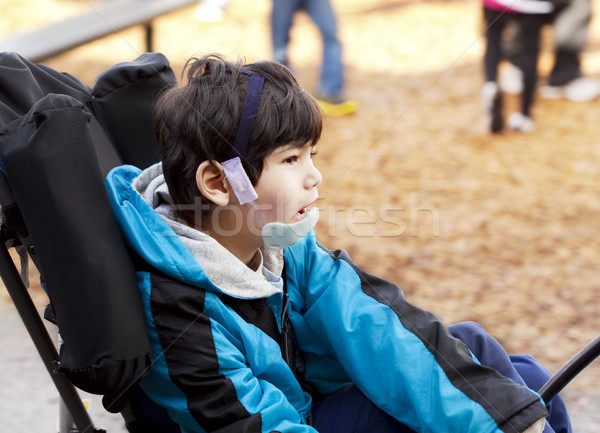 Cute six year old disabled boy in wheelchair on playground Stock photo © jarenwicklund