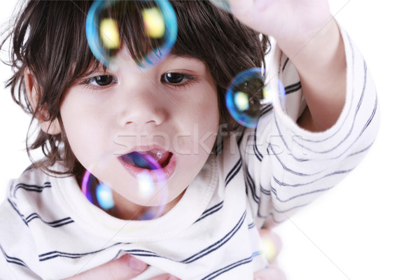 Toddler boy playing with bubbles Stock photo © jarenwicklund