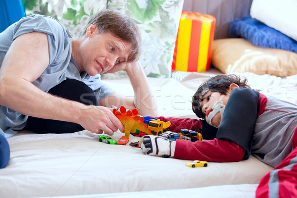 Handsome father playing cars with disabled son Stock photo © jarenwicklund