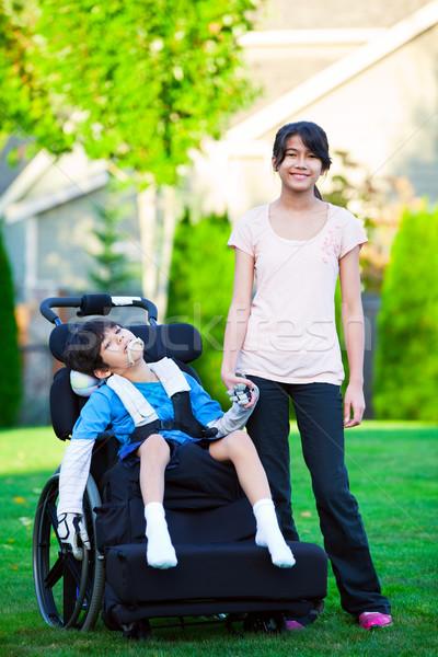 инвалидов мало мальчика коляске сестра травянистый Сток-фото © jarenwicklund