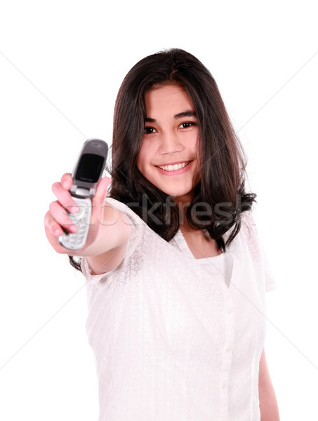 Biracial teen girl holding out cellphone Stock photo © jarenwicklund