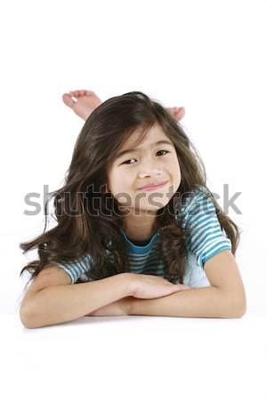 Hét éves lány fekszik padló mosolyog kamera Stock fotó © jarenwicklund