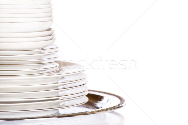 Stack of white dishes on silver platter Stock photo © jarenwicklund