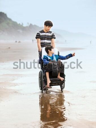 Stockfoto: Vader · gehandicapten · zoon · rolstoel · strandzand