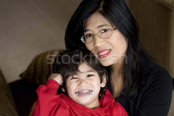 Mother holding disabled son Stock photo © jarenwicklund