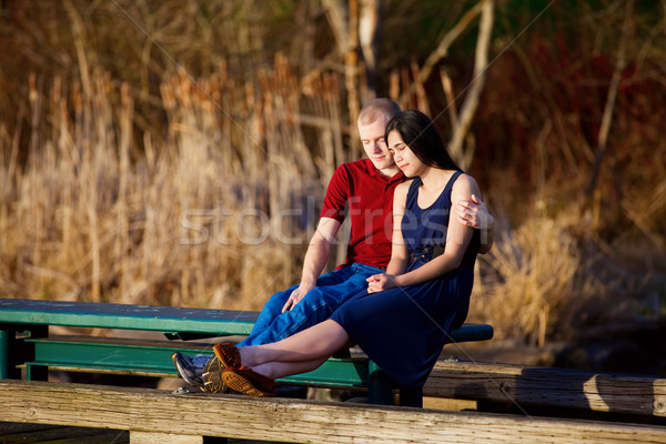 Young interracial couple enjoying time together on wooden pier o Stock photo © jarenwicklund