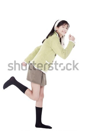 Girl in green sweater and skort in running position, isolated Stock photo © jarenwicklund