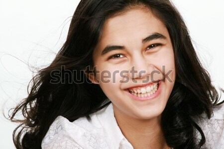 Beautiful biracial teen girl smiling, isolated Stock photo © jarenwicklund