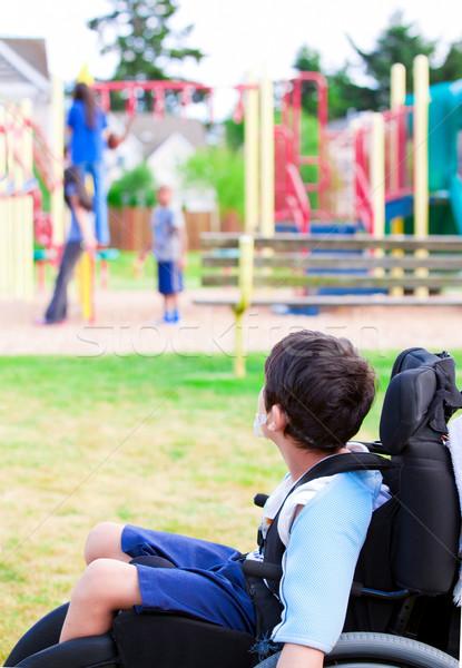 инвалидов мало мальчика коляске смотрят детей Сток-фото © jarenwicklund