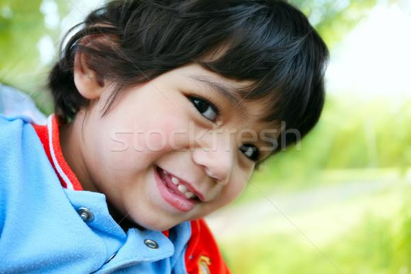 Happy toddler boy smiling, looking sideways at camera Stock photo © jarenwicklund