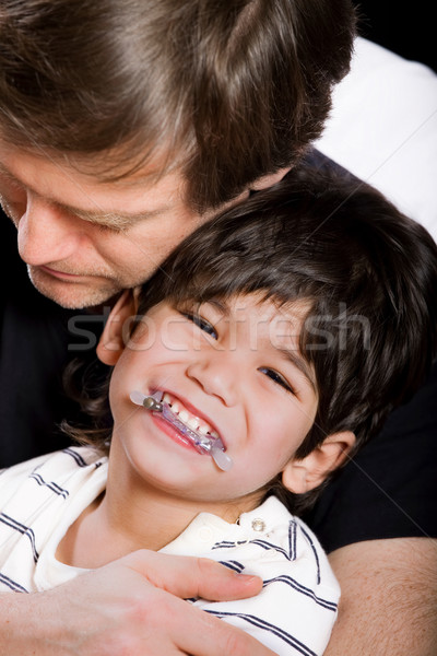 Young handsome father holding disabled son Stock photo © jarenwicklund
